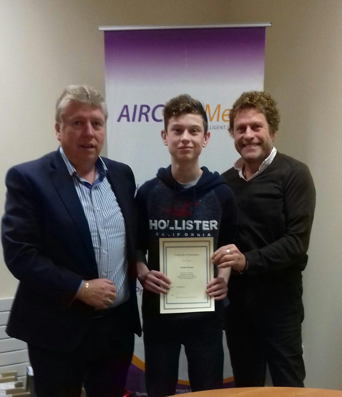 TY Student JOrdan Kirwan receives his Manual handling Certificate from Jim Mullett and John Dempsey